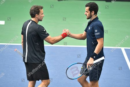 Mate Pavic (R) of Croatia and Bruno Soares of Brazil reacts during the men's doubles semifinal match against Jean-Julien Rojer of the Netherlands and Horia Tecau of Romania at the ATP Stockholm Open tennis tournament at the Royal Tennis Hall in Stockholm, Sweden, 19 October 2019.