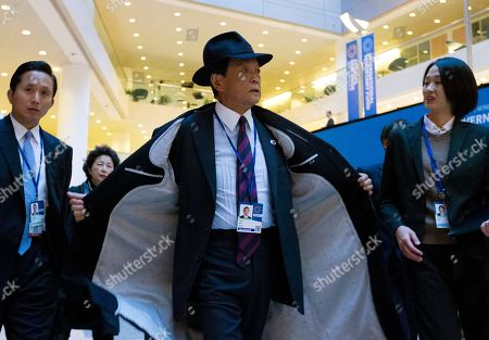 Japan's Finance Minister Taro Aso arrives for the International Monetary and Financial Committee breakfast meeting, during the World Bank/IMF Annual Meetings in Washington