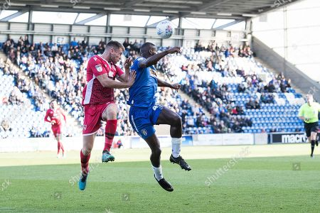 Frank Nouble of Colchester United heads on under pressure from Sam Lavelle  of Morecambe  during Colchester United vs Morecambe, Sky Bet EFL League 2 Football at the JobServe Community Stadium on 19th October 2019