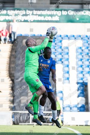 Barry Roche  of Morecambe collects from the head of Frank Nouble of Colchester United  during Colchester United vs Morecambe, Sky Bet EFL League 2 Football at the JobServe Community Stadium on 19th October 2019