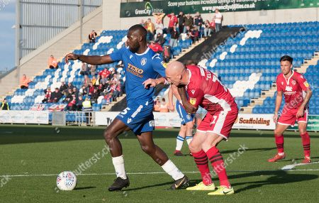 Kevin Ellison  of Morecambe holds up Frank Nouble of Colchester United  during Colchester United vs Morecambe, Sky Bet EFL League 2 Football at the JobServe Community Stadium on 19th October 2019