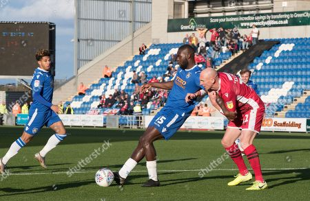 Frank Nouble of Colchester United lays the ball off under pressure from Kevin Ellison  of Morecambe  during Colchester United vs Morecambe, Sky Bet EFL League 2 Football at the JobServe Community Stadium on 19th October 2019