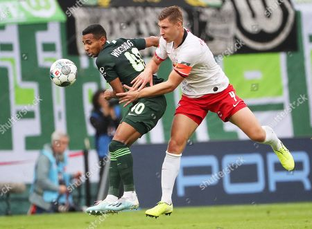Leipzig's Willi Orban (R) in action against Wolfsburg's Joao Victor Santos Sa during the German Bundesliga soccer match between RB Leipzig and VfL Wolfsburg, in Leipzig, Germany, 19 October 2019.