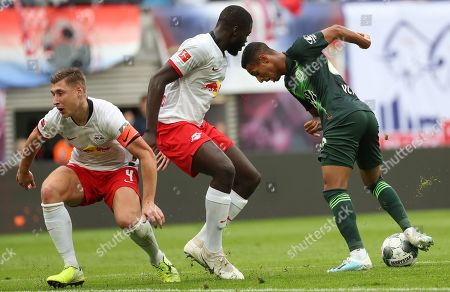 Stock Image of Leipzig's Willi Orban (L) and Leipzig's Dayot Upamecano (C) in action against Wolfsburg's Joao Victor Santos Sa during the German Bundesliga soccer match between RB Leipzig and VfL Wolfsburg, in Leipzig, Germany, 19 October 2019.
