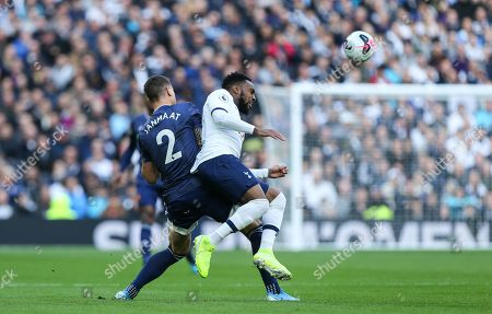 Daryl Janmaat of Watford and Danny Rose of Tottenham Hotspur challenge for the ball