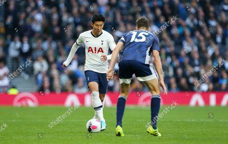 Son Heung-Min of Tottenham Hotspur runs at Craig Cathcart of Watford