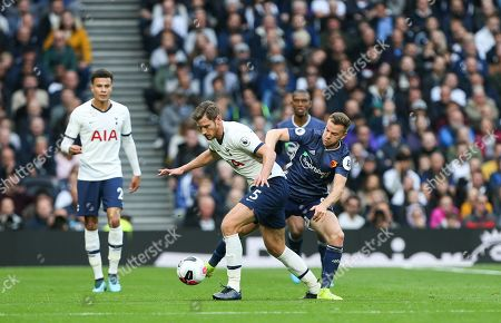 Jan Vertonghen of Tottenham Hotspur and Tom Cleverley of Watford tussle for the ball