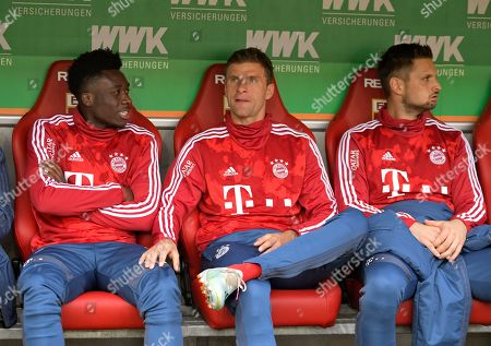 Stock Picture of 14.10.2019, Football 1. Bundesliga 2019/2020, 8. match day, FC Augsburg - FC Bayern Muenchen, in WWK-Arena Augsburg. v.li: Alphonso Davies (FC Bayern Muenchen), Thomas Mueller (FC Bayern Muenchen) and goalkeeper Sven Ulreich (FC Bayern Muenchen)