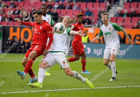 14.10.2019, Football 1. Bundesliga 2019/2020, 8. match day, FC Augsburg - FC Bayern Muenchen, in WWK-Arena Augsburg. v.li: Philippe Coutinho (Bayern Muenchen)  -  Tin Jedvaj (FC Augsburg).