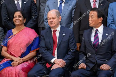 Nirmala Sitharaman (L), India's Minister of Finance, Olaf Scholz (C) , Germany's Minister of Finance and Taro Aso (L), Japan's Minister of Finance pose for a group photo of the International Monetary Fund Governors  during the IMF World Bank Annual Meetings in Washington, DC, USA, 19 October 2019.