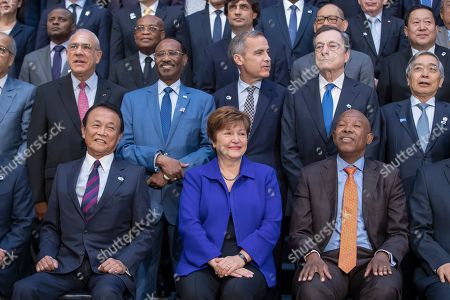 Stock Image of Kristalina Georgieva (C), Managing Director of the International Monetary Fund poses with Taro Aso (L), Japan's Minister of Finance and Lesetja Kganyago (R) of South Africa, Chairman for the International Monetary and Financial Committee, during group photo of the International Monetary Fund Governors  during the IMF World Bank Annual Meetings in Washington, DC, USA, 19 October 2019.