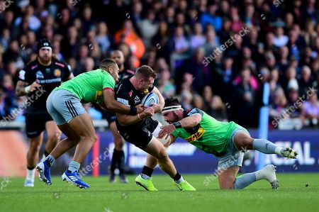 Sam Simmonds of Exeter Chiefs is tackled by Scott Baldwin of Harlequins and Joe Marchant of Harlequins