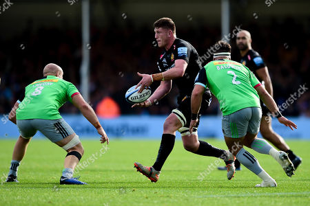 Jacques Vermeulen of Exeter Chiefs is marked by Tom Lawday of Harlequins and Scott Baldwin of Harlequins