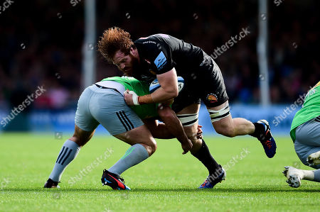 Stock Image of Jannes Kirsten of Exeter Chiefs is tackled by Scott Baldwin of Harlequins