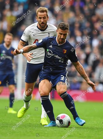 Tottenham Hotspur's Harry Kane (L) in action against Watford's Daryl Janmaat (R) during the English Premier League soccer match between Tottenham Hotspur and Watford FC in London, Britain, 19 October 2019.