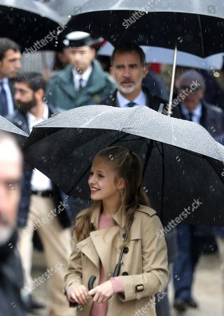 King Felipe VI of Spain (background) and his daughter Crown Princess Leonor (foreground) visit Asiegu, small village winner of the Exemplary Town of Asturias Award, in Asturias, Spain, 19 October 2019. The town was awarded with the traditional prize for keeping their traditions and for their project of rural development.