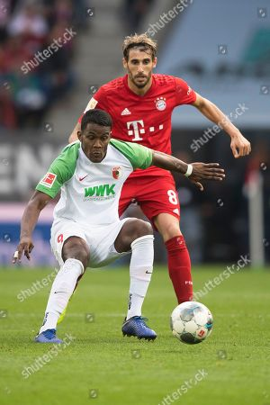 Augsburg's Sergio Cordova (L) in action against Bayern Munich's Javi Martinez (R) during the German Bundesliga soccer match between FC Augsburg and FC Bayern Munich in Augsburg, Germany, 19 October 2019.