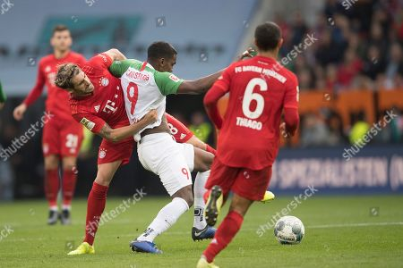 Bayern's Javi Martinez (L) and Augsburg's Sergio Cordova (R) in action during the German Bundesliga soccer match between FC Augsburg and FC Bayern Munich in Augsburg, Germany, 19 October 2019.