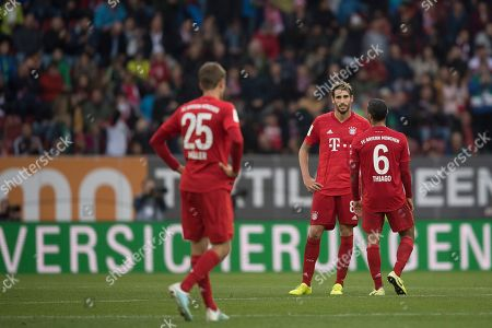 Bayern's Thomas Mueller (L), Javi Martinez (M) and Thiago (R) reacts after the German Bundesliga soccer match between FC Augsburg and FC Bayern Munich in Augsburg, Germany, 19 October 2019.
