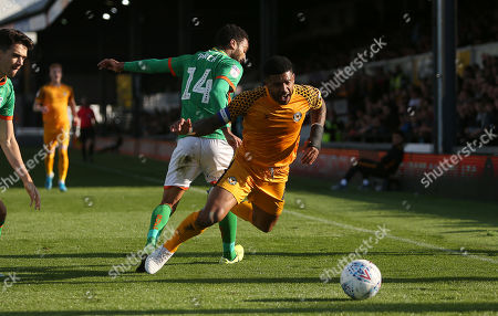 Joss Labadie of Newport County is tackled by James Perch of Scunthorpe United.