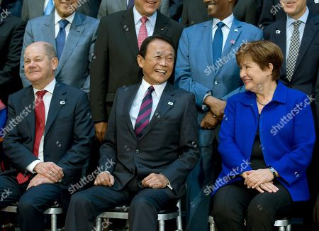 From left, German Finance Minister Olaf Scholz, Japan's Finance Minister Taro Aso and International Monetary Fund (IMF) Managing Director Kristalina Georgieva during the International Monetary Fund IMF Governors group photo a at the World Bank/IMF Annual Meetings in Washington