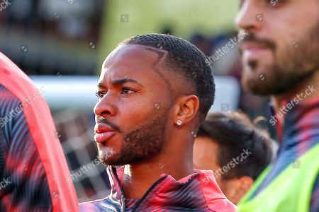 Manchester City midfielder Raheem Sterling (7), haircut,  warming up before the Premier League match between Crystal Palace and Manchester City at Selhurst Park, London