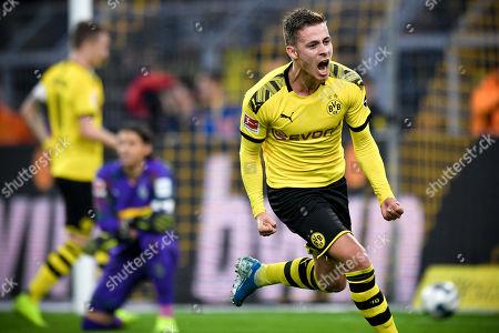 Dortmund's Thorgan Hazard (R) celebrates after scoring an offside goal during the German Bundesliga soccer match between Borussia Dortmund and Borussia Moenchengladbach in Dortmund, Germany, 19 October 2019.