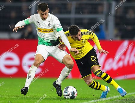 Moenchengladbach's Stefan Lainer (L) in action against Dortmund's Thorgan Hazard (R) during the German Bundesliga soccer match between Borussia Dortmund and Borussia Moenchengladbach in Dortmund, Germany, 19 October 2019.