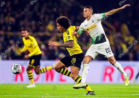 Stock Photo of Dortmund's Axel Witsel (C) in action against Moenchengladbach's Laszlo Benes (R) during the German Bundesliga soccer match between Borussia Dortmund and Borussia Moenchengladbach in Dortmund, Germany, 19 October 2019.