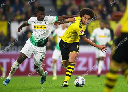 Dortmund's Axel Witsel (R) in action against Moenchengladbach's Breel Embolo (L) during the German Bundesliga soccer match between Borussia Dortmund and Borussia Moenchengladbach in Dortmund, Germany, 19 October 2019.