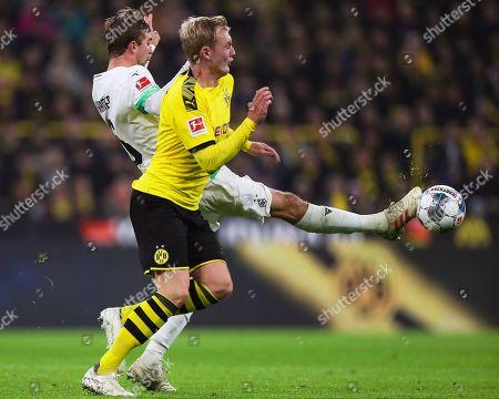 Moenchengladbach's Christoph Kramer (back) in action against Dortmund's Julian Brandt (front) during the German Bundesliga soccer match between Borussia Dortmund and Borussia Moenchengladbach in Dortmund, Germany, 19 October 2019.