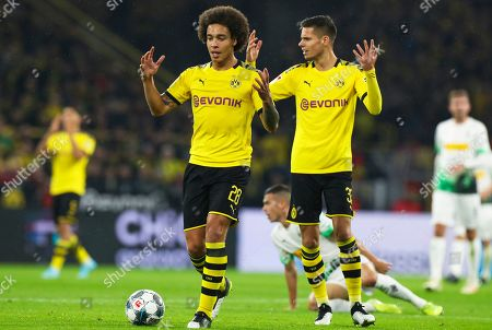 Dortmund players Axel Witsel (L) and Julian Weigl (R) react during the German Bundesliga soccer match between Borussia Dortmund and Borussia Moenchengladbach in Dortmund, Germany, 19 October 2019.