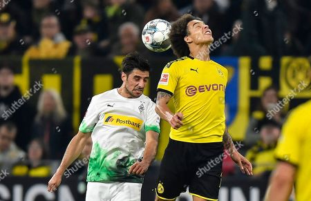 Dortmund's Axel Witsel, right, and Moenchengladbach's Lars Stindl, left, challenge for the ball during the German Bundesliga soccer match between Borussia Dortmund and Borussia Moenchengladbach in Dortmund, Germany
