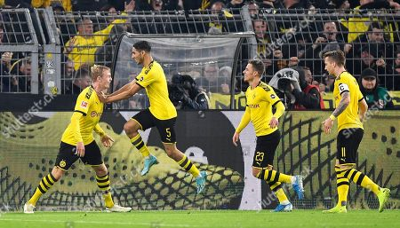 Dortmund's Julian Brandt is celebrated by Achraf Hakimi, Thorgan Hazard and Marco Reus, from left, after scoring a goal that was later cancelled by the referees during the German Bundesliga soccer match between Borussia Dortmund and Borussia Moenchengladbach in Dortmund, Germany