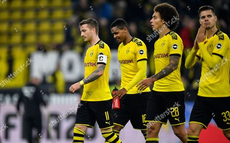 Stock Image of Dortmund's Marco Reus, Manuel Akanji, Axel Witsel and Julian Weigl, from left, leave the pitch after the German Bundesliga soccer match between Borussia Dortmund and Borussia Moenchengladbach in Dortmund, Germany