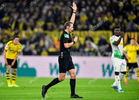 Referee Sascha Stegemann cancels the opening goal by Dortmund's Thorgan Hazard because of offside during the German Bundesliga soccer match between Borussia Dortmund and Borussia Moenchengladbach in Dortmund, Germany