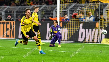 Dortmund's Thorgan Hazard celebrates after scoring a goal that was cancelled by the video referee during the German Bundesliga soccer match between Borussia Dortmund and Borussia Moenchengladbach in Dortmund, Germany