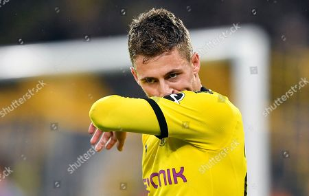 Stock Image of Dortmund's Thorgan Hazard reacts after scoring before his goal is canceled by the video referee during the German Bundesliga soccer match between Borussia Dortmund and Borussia Moenchengladbach in Dortmund, Germany