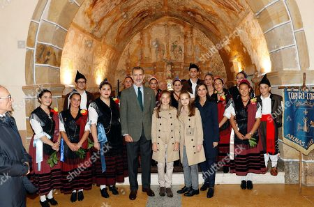 A handout picture made available by the Royal House shows King Felipe VI of Spain (5-L), Queen Letizia of Spain (4-R), Infanta Sofia (6-L) and Crown Princess Leonor (5-R) during their visit to Asiegu, small village winner of the Exemplary Town of Asturias Award, in Asturias, Spain, 19 October 2019. The town was awarded with the traditional prize for keeping their traditions and for their project of rural development.