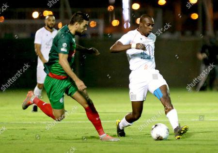 Al Shabab player Seba (L) in action against  Al Ettifaq player Oussama Haddadi (R) during the Saudi Professional League soccer match between Al Shabab and Al Ettifaq at Prince Prince Khalid Bin Sultan Stadium, Riyadh, Saudi Arabia, 19 October 2019.