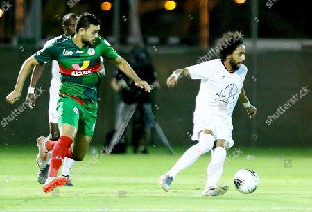 Al Shabab player Abdulmajeed Al Sulayhim (R) in action against  Al Ettifaq player Oussama Haddadi (L) during the Saudi Professional League soccer match between Al Shabab and Al Ettifaq at Prince Prince Khalid Bin Sultan Stadium, Riyadh, Saudi Arabia, 19 October 2019.