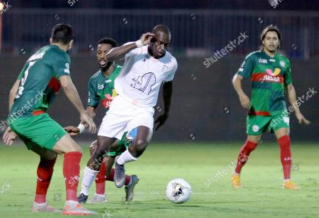Al Shabab player Seba (C) in action against  Al Ettifaq player Oussama Haddadi (L) during the Saudi Professional League soccer match between Al Shabab and Al Ettifaq at Prince Prince Khalid Bin Sultan Stadium, Riyadh, Saudi Arabia, 19 October 2019.