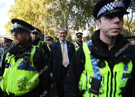 Member of Parliament, Bill Cash (C) leaves the Houses of Parliament escorted by police in London, Britain, 19 October 2019. The MP's voted to delay the approval of a Brexit deal as hundreds of thousands of people are taking part in the protest march calling for a referendum on the final Brexit deal on 'Super Saturday'.