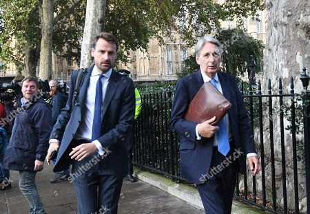 Member of Parliament Philip Hammond (R) leaves the Houses of Parliament in London, Britain, 19 October 2019. The MP's voted to delay the approval of a Brexit deal as hundreds of thousands of people are taking part in the protest march calling for a referendum on the final Brexit deal on 'Super Saturday'.