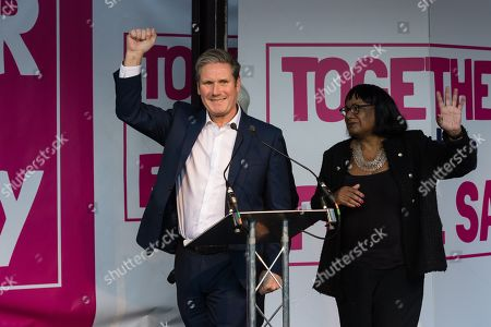 Shadow Brexit Secretary Keir Starmer (R) attends a rally in Parliament Square as hundreds of thousands of people take part in the anti Brexit 'Together for the Final Say' march through central London to demand a public vote on the outcome of Brexit.