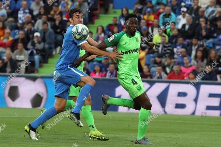 Leganes' Kenneth Omeruo (R) vies for the ball with Getafe's Jaime Mata (L) during the Spanish La Liga soccer match between Getafe CF and CD Leganes in Getafe, near Madrid, Spain, 19 October 2019.