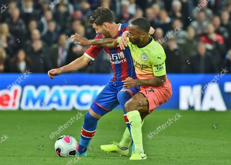 Manchester City's Raheem Sterling, right, fights for the ball with Crystal Palace's Joel Ward during the English Premier League soccer match between Crystal Palace and Manchester City at Selhurst Park in London, England