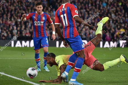 Manchester City's Raheem Sterling falls during the English Premier League soccer match between Crystal Palace and Manchester City at Selhurst Park in London, England