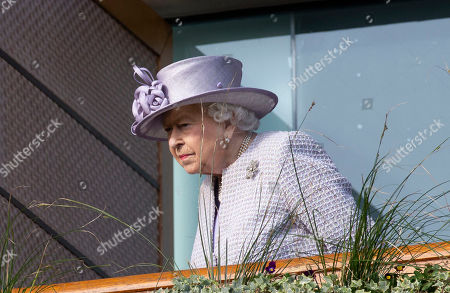 Queen Elizabeth II watches the parade ring from the balcony at the QIPCO Champions day.