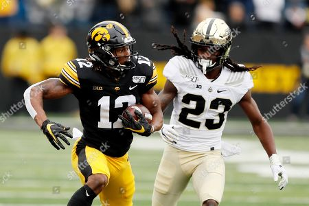 Brandon Smith, Cory Trice. Iowa wide receiver Brandon Smith, left, catches a pass ahead of Purdue safety Cory Trice during the first half of an NCAA college football game, in Iowa City, Iowa